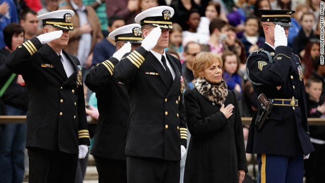 Accompanied by members of the U.S. Navy SEALs, Carmella LaSpada (2nd R), White House Special Projects Aide to President John F. Kennedy, participates in a wreath laying ceremony at the Tomb of the Unknowns in honor of Kennedy at Arlington National Cemetery November 22, 2013 in Arlington, Virginia.