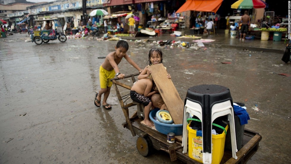 Children salvage reusable items in a waterfront community in Tacloban, Philippines, on November 23.