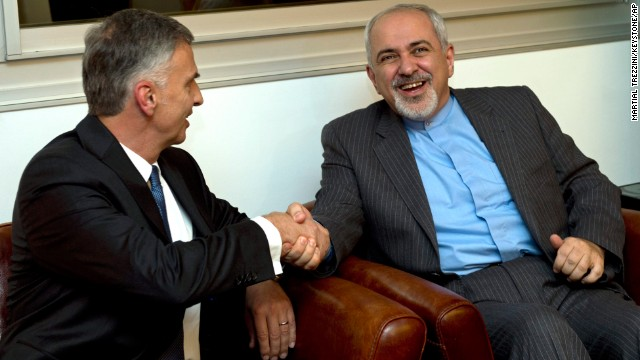 Switzerland's Foreign Minister Didier Burkhalter, left, shakes hands with Iranian Foreign Minister Mohammad-Javad Zarif, during a meeting at the Intercontinental Hotel prior to talks about Iran's nuclear programme in Geneva, Switzerland, on Saturday, November 23.