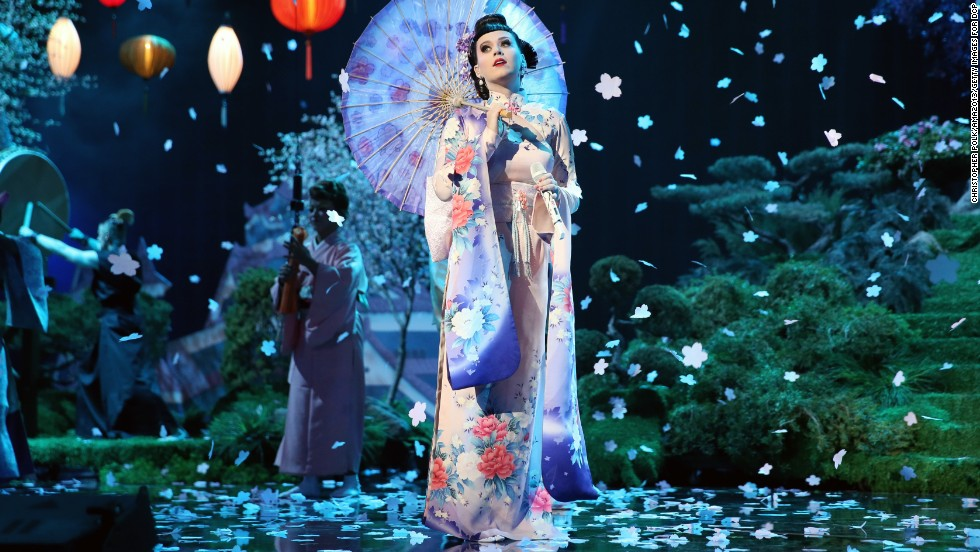 "Katy Perry opens the show in full kimono on an Asian-inspired set for her song ""Unconditionally."""