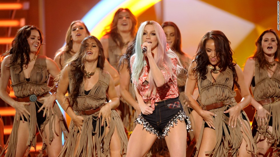 Ke$ha performs with backup dancers dressed like Native Americans.