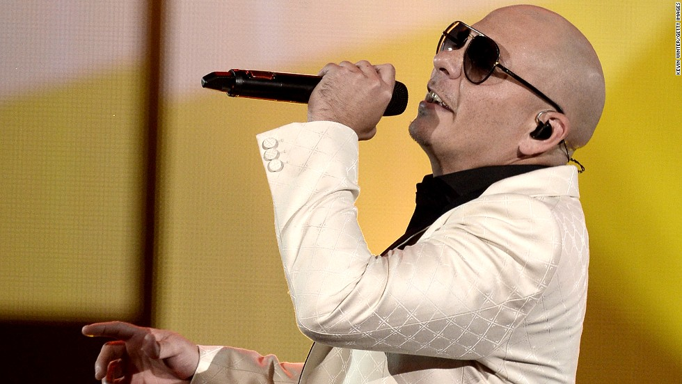 "Rapper Pitbull performs his new single, ""Timber,"" with Ke$ha. He hosted the award show."