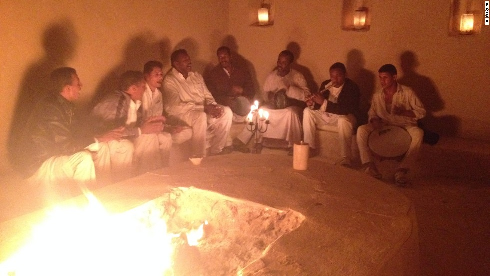 Local Siwans gather around a fire to sing songs about love and life in their native tongue.