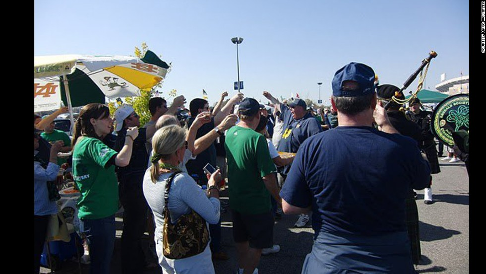 Wolnitzek, center right in the Notre Dame apron, leads a toast during his tailgate.
