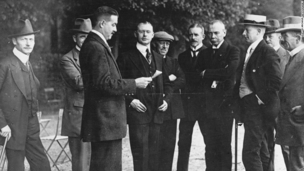 German delegates talk in May 1919 during the signing of the Treaty of Versailles in France. The agreement, which severely punished Germany, ended World War I but sowed the seeds of World War II.
