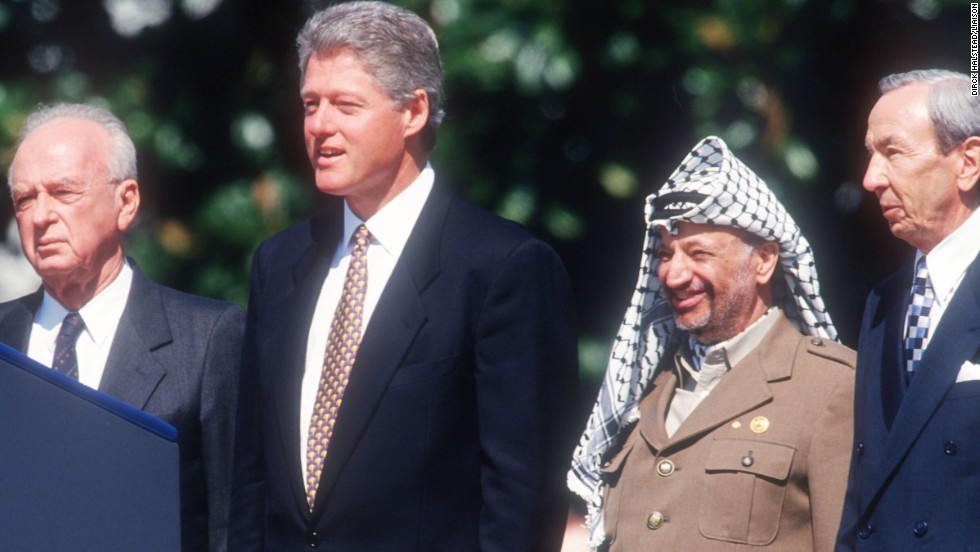 Israeli Prime Minister Yitzhak Rabin, U.S. President Bill Clinton, Palestinian leader Yasser Arafat and U.S. Secretary of State Warren Christopher pose in September 1993 after announcing the terms of the Oslo Accord. The pact established a timetable for the Middle East peace process.