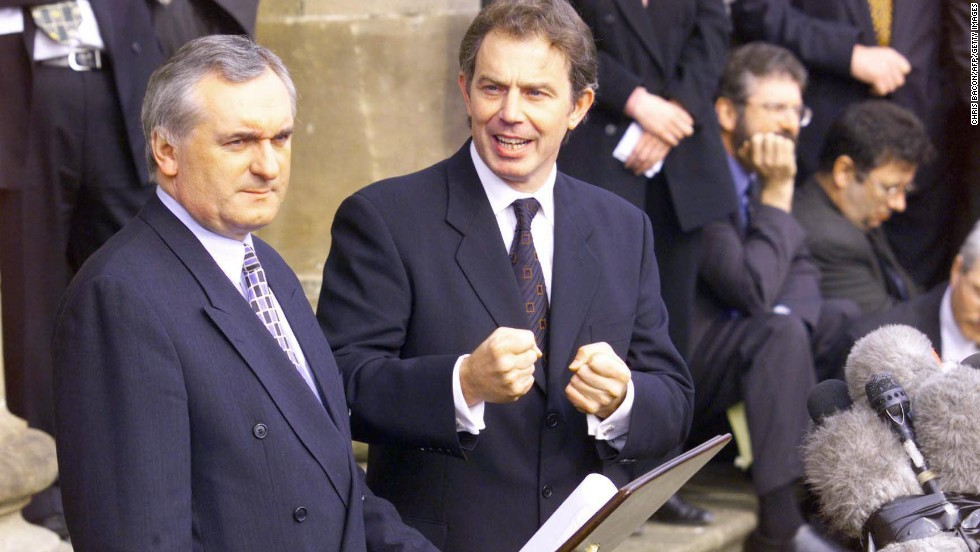 Irish Premier Bertie Ahern and British Prime Minister Tony Blair speak during a news conference near Belfast, Northern Ireland, on the first anniversary of the Good Friday Agreement. The 1998 deal created a 108-member Assembly and a 14-member executive body in which both Catholic and Protestant political representatives sit together in government.