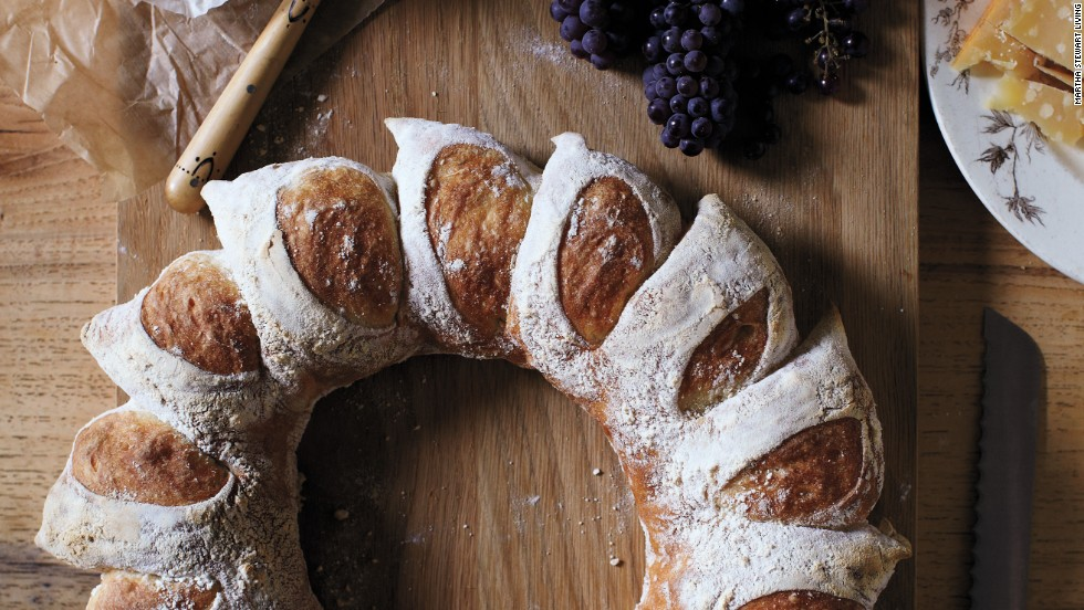 A circular loaf mimics the look of the corn-husk wreath—and a clever cutting technique creates radiant sections. When it's time to eat this centerpiece-worthy bread, it easily breaks into perfect portions.<strong>Supplies: </strong>Bread dough, All-purpose flour, Scissors<strong>How-to:</strong> 1. Punch into center of dough and make a hole, using your fingers to pull dough into a ring shape. 2. Generously dust top of dough with flour. Holding scissors at a 45-degree angle, snip a deep V into top of ring. Repeat every inch or so around ring. 3. Gently lift each snipped portion and splay outward, creating rays. Bake wreath.