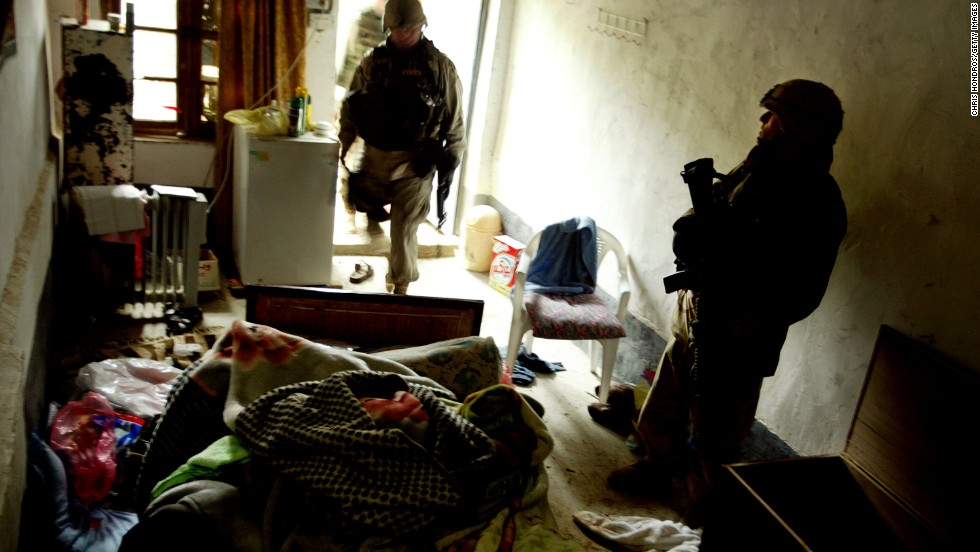 U.S. soldiers guard a small concrete room in the compound where Hussein was captured.