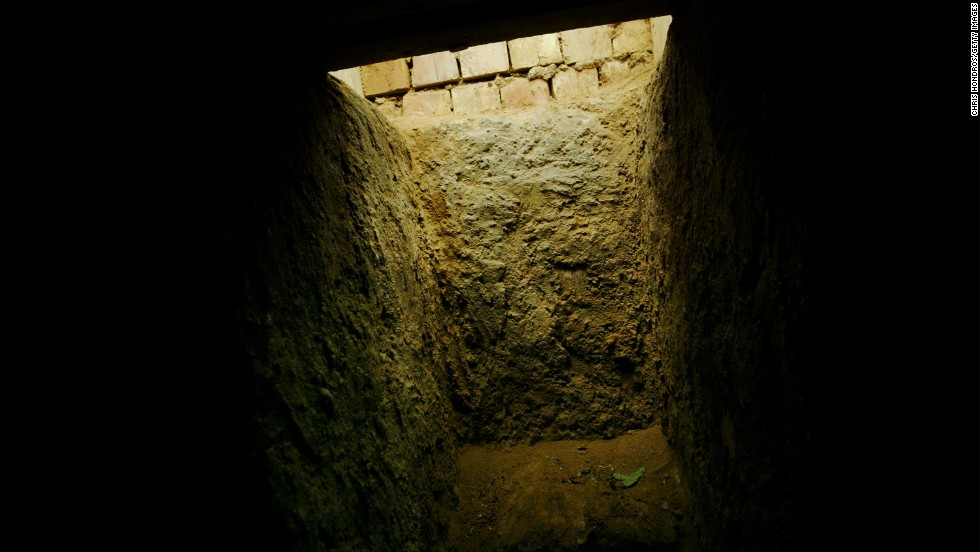 "The entrance to the ""spider hole"" where Hussein was hiding."