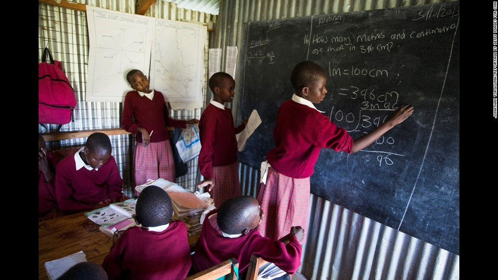 "Students practice their math at Ntaiya's school. ""Now, they can focus on their studies -- and on being kids,"" Ntaiya said. ""It's the only way you can give a girl child a chance to excel."""