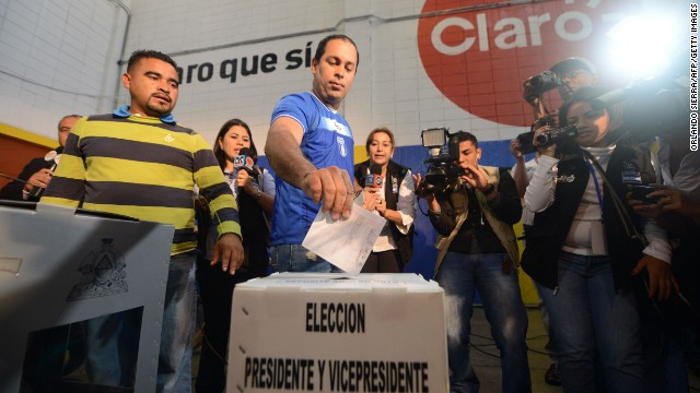 A man casts his vote at a polling station during the general elections, in Tegucigalpa on November 24, 2013. Polls opened Sunday in Honduras, the world's deadliest country, where the top presidential contenders are the wife of a deposed president and a supporter of the coup that ousted him.