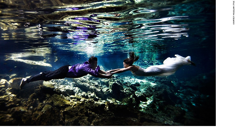 """About 100 guests flew to Mexico for a wedding at the Blue Bay Grand Esmerelda. On a hunt for something more than the """"regular beach image,"""" the McLellan Style team and their newlyweds chose an underwater cave (cenote). """"We tried shooting in all sorts of different areas with light coming in from different directions,"""" says McLellan. The prolonged shoot led to this photo, a rushed drive to the airport, a speeding ticket and a missed flight. """"But that's OK, it was worth it,"""" says McLellan."""