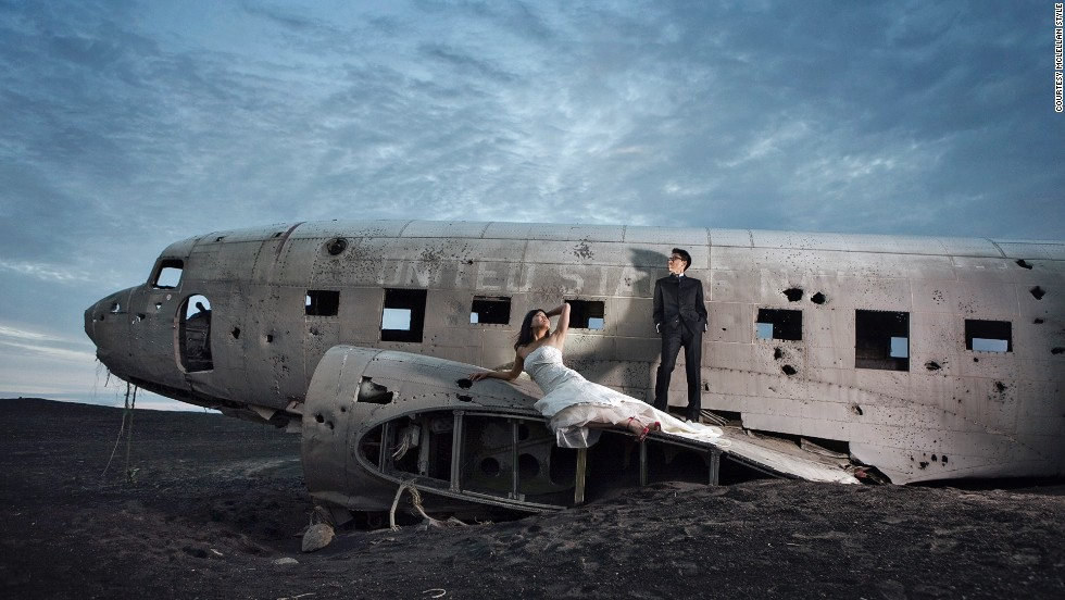"""Sean McLellan, of husband-and-wife team McLellan Style, worked with a New York couple who chose Iceland for their wedding photographs. The Nashville-based photographer knew of a U.S. Navy plane that had crash-landed in the 1970s. Despite a satellite picture from Google Maps and GPS coordinates, it took the photographer and couple more than three hours to  find the plane. """"This image was actually taken at close to midnight by the time we were able to get there and get everything set up."""""""
