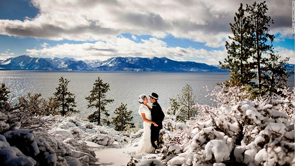"Stunning backdrops, expensive gowns, strung-out couples on the most important day of their lives ... how much drama can be packed into a single photo? We asked well known destination wedding photographers for their most striking work. For a winter wedding at Lake Tahoe, guests bundled up in down jackets and boots and huddled in the snow. Photographer Aaron Morris of Chrisman Studios says the main challenge, aside from frozen hands, was maneuvering in the snow. ""When I would take a step, my leg would sink knee-deep into the snow,"" he says."
