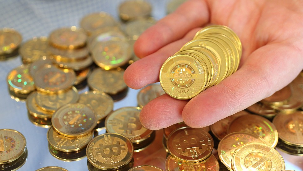 Bitcoin is an experimental digital crypto-currency unregulated by a central bank where its value -- like many real-world currencies -- is determined by how much people are willing to use it. Here, software engineer Mike Caldwell of Sandy, Utah holds physical Bitcoins he minted in his shop in April this year.