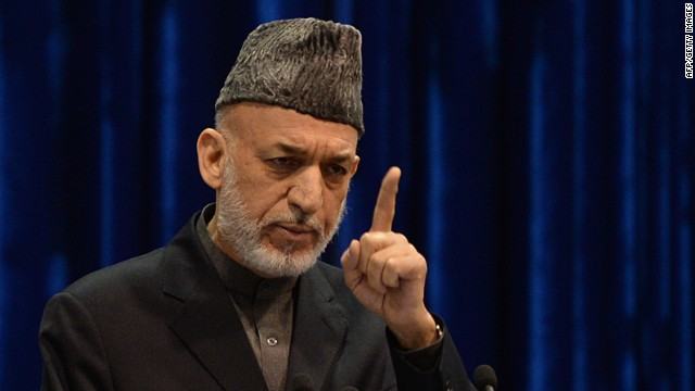 Afghan President Hamid Karzai addresses the loya jirga, a meeting of tribal elders and leaders, in Kabul on November 24, 2013.