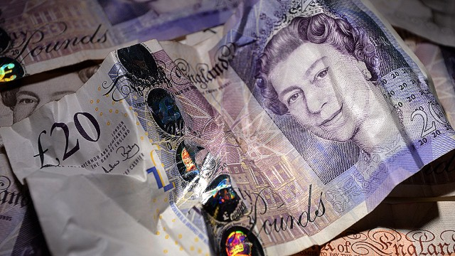 An illustrative picture taken in London on February 25, 2013 shows an arrangement of British 10 and 20 pound bank notes. Moody's stripped Britain of its triple-A debt rating after markets closed on February 22, 2013, saying government debt was still mounting and that growth was too weak to reverse the trend before 2016 -- heaping more pressure on the pound. After hitting a fresh low-point on February 22, the pound recovered in trading in London to reach 1.5143 USD on February 25, compared with 1.5162 USD on February 22. AFP PHOTO / BEN STANSALLBEN STANSALL/AFP/Getty Images