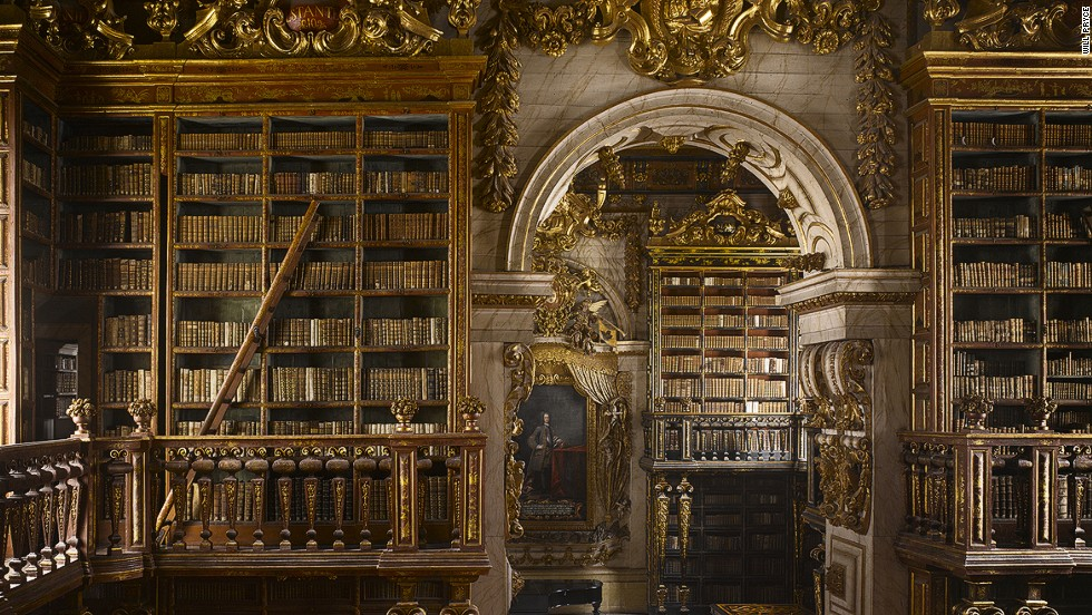 "<strong><br /><br />Will Pryc</strong>e: ""This is a very imposing library from a time when Portugal was extremely wealthy and powerful. It is very dark but features intricate gold leaf which gives it magical luminosity. The backs of the bookcases each have different color, and there are integrated ladders that pull out, and secret doors that lead to reading rooms."""
