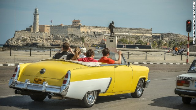 Tourists take a ride along the coast in Havana, which may become even harder for U.S. citizens and Cuban expats to reach after Cuba's government suspended all consular services to the United States on Tuesday.