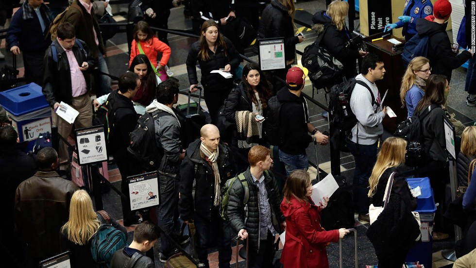 Travelers wait in security lines at Reagan National Airport on November 26.