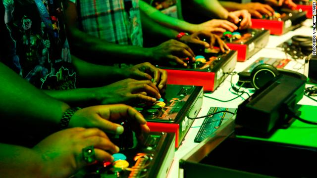 Gamers, like these at the E3 expo in June, have three good options when considering gaming consoles this  holiday season.