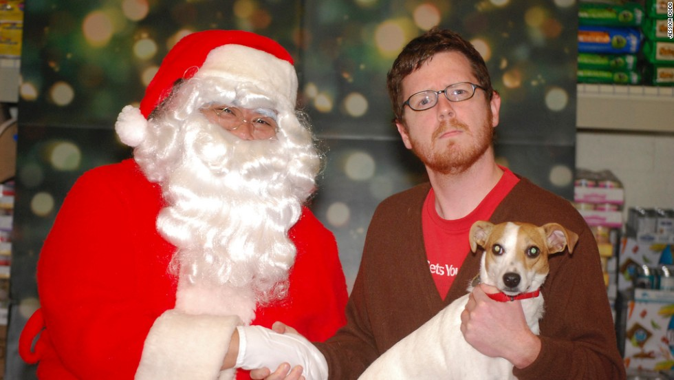 Terry Nagurney shakes hands with Santa with his dog, Abby, on his lap. This photo was taken at a charity event in Atlanta PetSmart to benefit Furkids, Georgia's largest, no-kill, cage-free cat shelter.