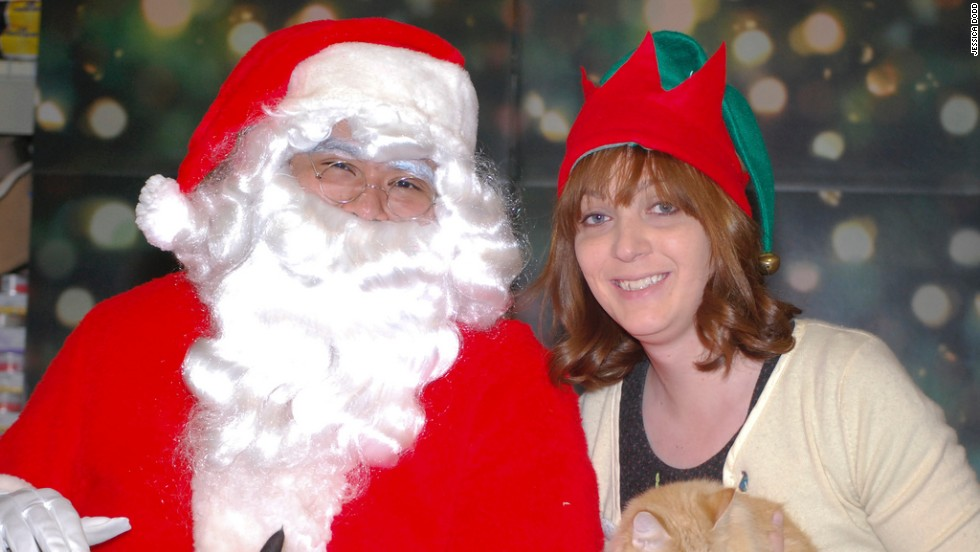 Carissa Rhea, right, poses with Santa and her cats Wall-E and Eve during the Furkids charity event in 2010.