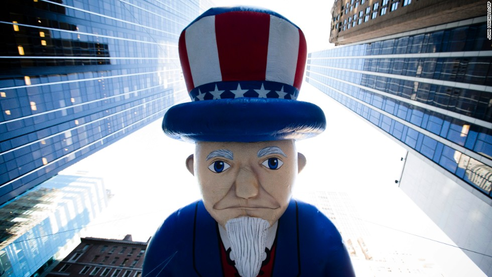 The Uncle Sam balloon is marched down Sixth Avenue.
