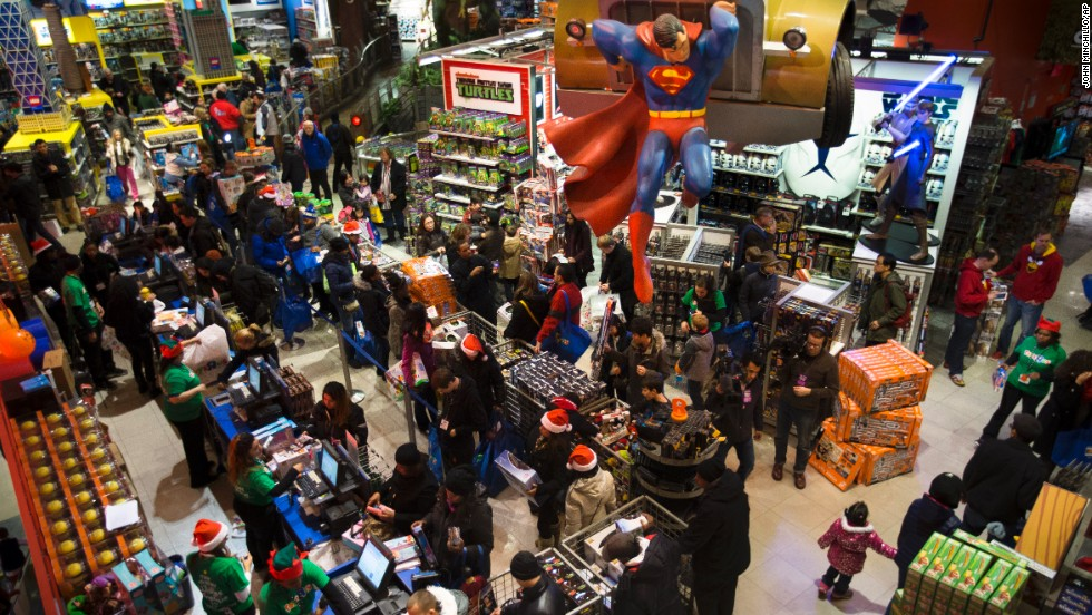 Customers wait in line to make their purchases at the Times Square Toys R Us on Thursday, November 28. More than a dozen retailers started their Black Friday sales early, opening on the evening of Thanksgiving.