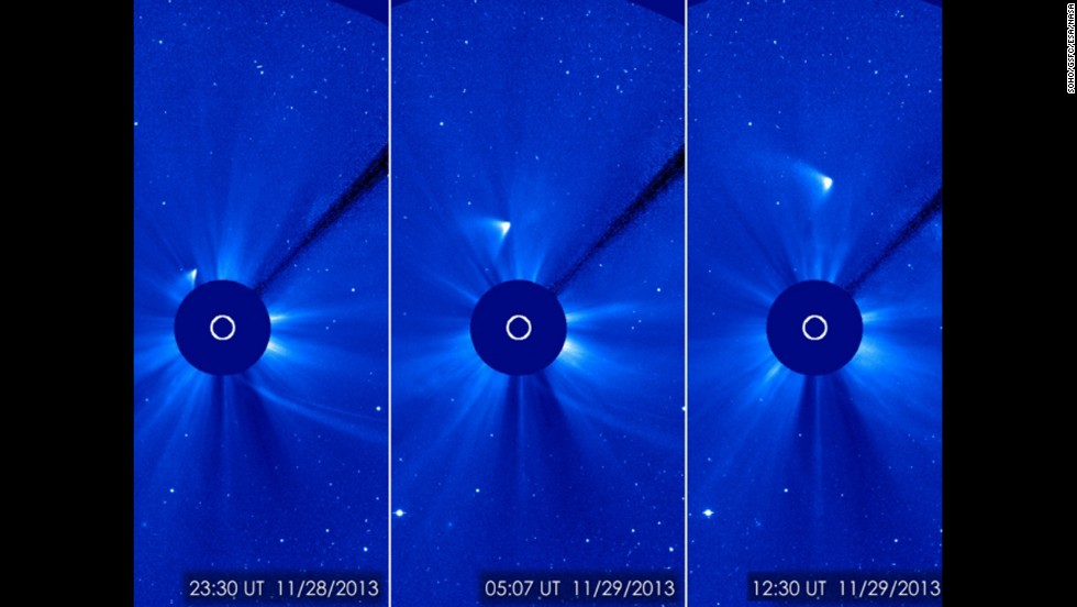 Comet ISON appears as a white smear heading up and away from the sun on Thursday, November 28. Scientists initially thought the comet had been disintegrated by the sun, but images suggest a small nucleus may still be intact.