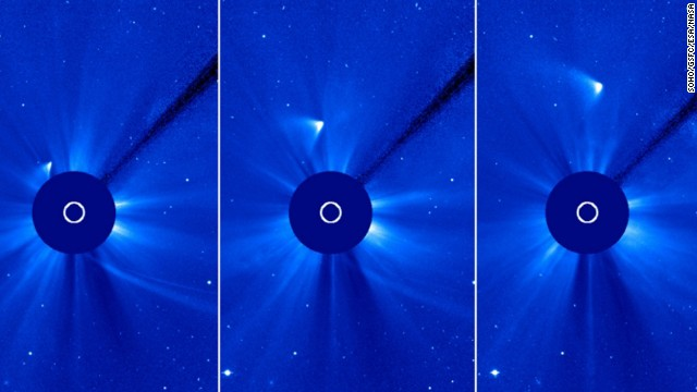 ISON appears as a white smear heading up and away from the sun. ISON was not visible during its closest approach to the sun, so many scientists thought it had disintegrated, but images like this one from the ESA/NASA Solar and Heliospheric Observatory suggest that a small nucleus may be intact.