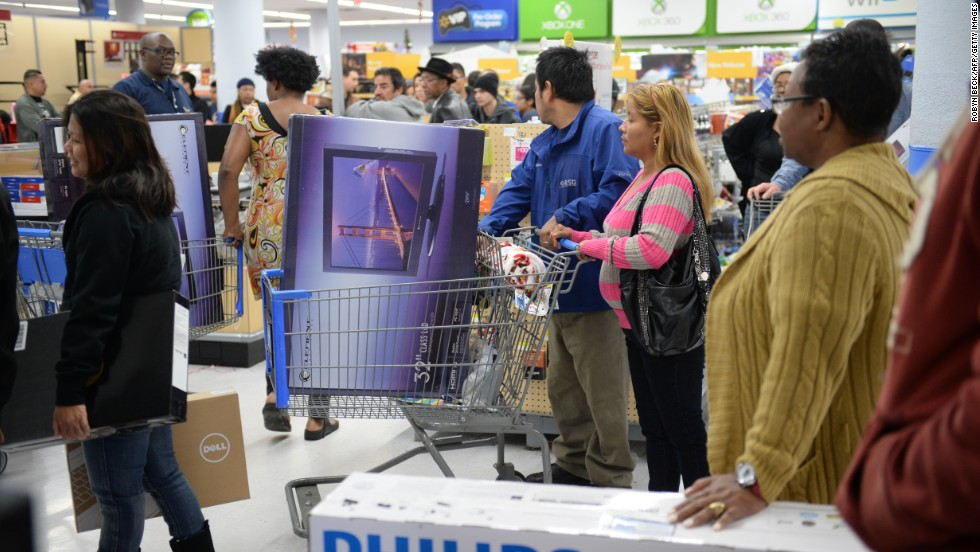 People line up to pay for their items at a Walmart in Los Angeles on November 29.