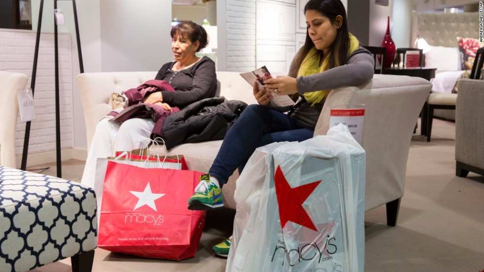 Rosa Martines and Olivia Lares take a break while shopping at a Chicago Macy's on November 29.