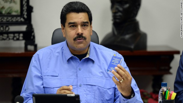 Venezuelan President Nicolas Maduro speaks on national network from the Miraflores presidential palace in Caracas on November 29, 2013 to announce his new pack of economic measures. AFP PHOTO/JUAN BARRETO (Photo credit should read JUAN BARRETO/AFP/Getty Images)