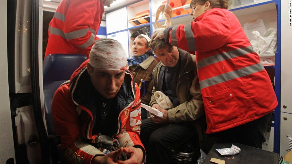 Injured protesters receive medical help in an ambulance after riot police broke up a rally on November 30.