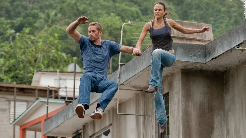 "Walker and Jordana Brewster -- who played his love interest, Mia, in the films -- in ""Fast 5."""