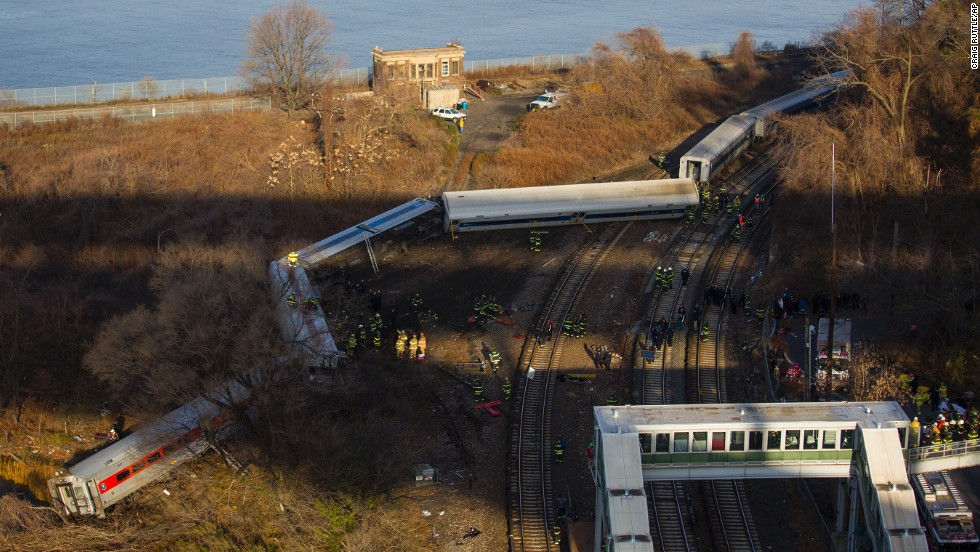 First responders gather around the derailment on December 1. Of eight train cars, seven were off the tracks.