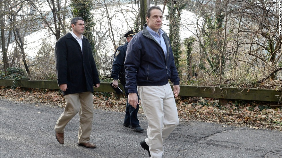 New York Gov. Andrew Cuomo, right, arrives on the scene December 1.