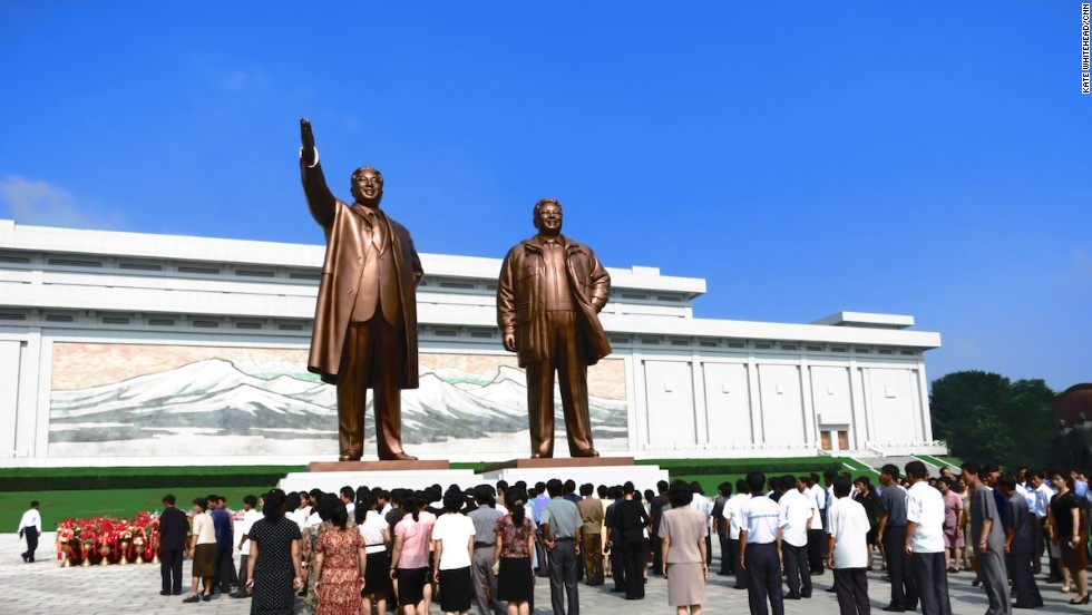Statues of Kim Il Sung (left) and Kim Jong Il (right) at Mansudae in Pyongyang. North Koreans gather in front of the statues to lay flowers and bow, showing their respect for the late and current leader. Tourists visiting North Korea are expected to do the same.