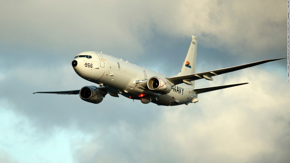 A P-8A Poseidon, the Navy's newest anti-submarine warfare and surveillance plane, conducts flyovers above the Enterprise Carrier Strike Group during exercise Bold Alligator 2012.