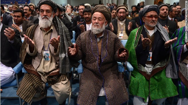 Members of the Afghan loya jirga, a meeting of around 2,500 tribal elders, pray on the last day of the four-day meeting.