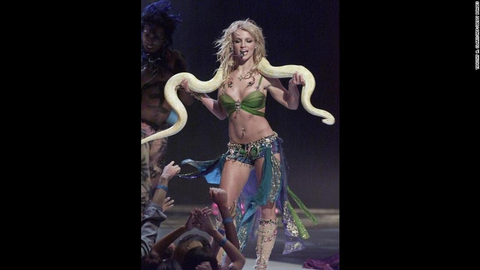 Spears famously performs with a snake draped over her shoulders at the 2001 MTV Video Music Awards.