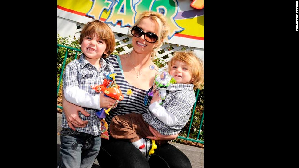 Spears poses with her sons, Preston and Jayden, at the Magic Kingdom in Lake Buena Vista, Florida, in 2009.