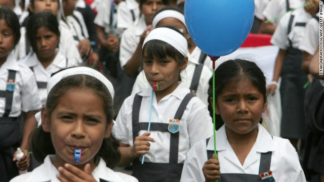 Callao, PERU: Schoolchildren take part in a protest march 26 April 2007 in Lima. Hundreds of students marched Thursday demanding a better quality and more investment in education. AFP PHOTO/Eitan ABRAMOVICH (Photo credit should read EITAN ABRAMOVICH/AFP/Getty Images)