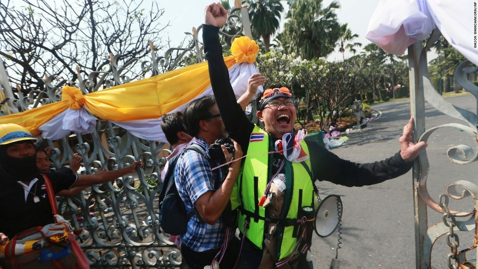 A protester celebrates after opening the gate of Government House on December 3.
