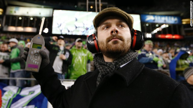 Matt Roe, an acoustical consultant with SSA Acoustics, measures noise levels in CenturyLink Field during an NFL football game between the Seattle Seahawks and the New Orleans Saints, Monday, Dec. 2, 2013, in Seattle. Fans attempted to set a Guinness World Record for crowd noise during the game. (AP Photo/John Froschauer)