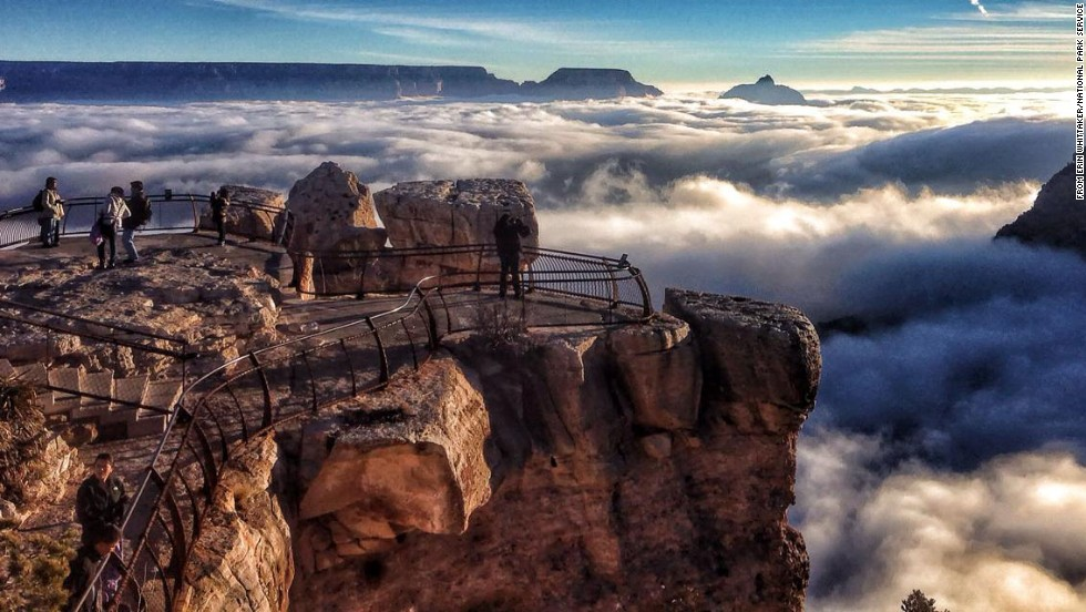 "Grand Canyon National Park in Arizona was the second most popular national park last year. Shown here is <a href=""http://www.cnn.com/2013/12/03/travel/grand-canyon-inversion/index.html?iref=allsearch"">an inversion:</a> cold fog trapped in the canyon by a ""lid"" of warm air. What makes it rare are the sunny skies accentuating the layers of air."