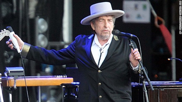 "FILE - This July 22, 2012 file photo shows U.S. singer-songwriter Bob Dylan performing on stage at ""Les Vieilles Charrues"" Festival in Carhaix, western France. French authorities have filed preliminary charges against Bob Dylan over an interview in which he is quoted comparing Croatians to Nazis and the Ku Klux Klan. Paris prosecutor's office spokeswoman Agnes Thibault-Lecuivre said Monday the charges of ""public insult and inciting hate"" were filed in mid-November.The charges stemmed from a lawsuit by a Croatian advocacy group in France over an interview in Rolling Stone magazine in 2012. (AP Photo/David Vincent, file)"