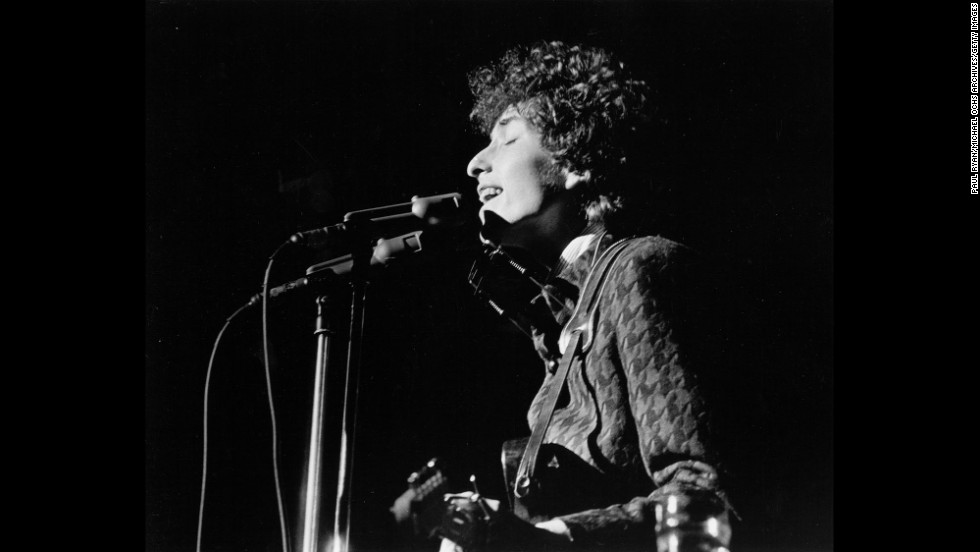 Dylan performs on stage in the 1960s. Dylan was known in his early career for playing the guitar and the harmonica, and for his distinctive vocal phrasing.